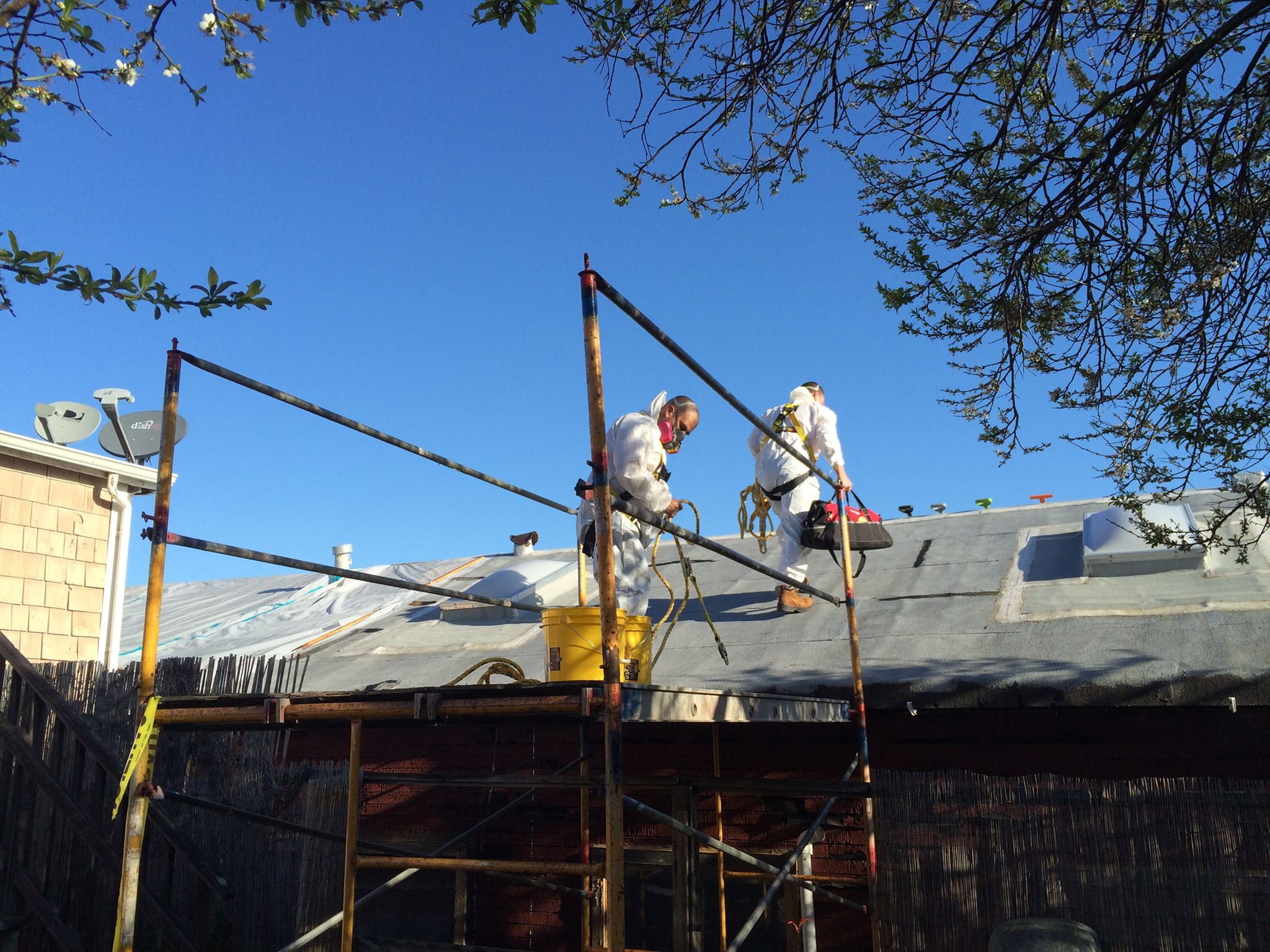 MESS Clean Up worksite on roof top job. Serving California's Central Coast with Asbestos, Mold, Lead, and Selective Demolition